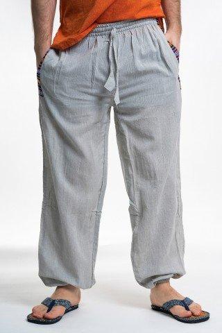 Pantaloni gri cu buzunare si motive etince