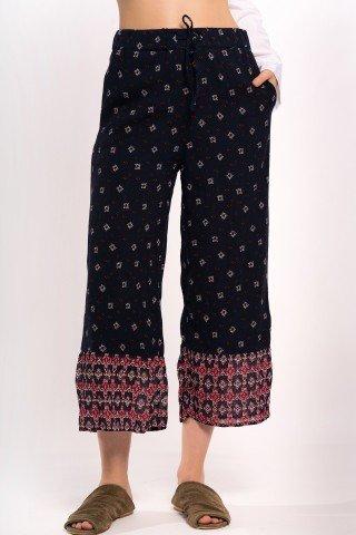 Pantaloni largi bleumarin cu volan si print geometric